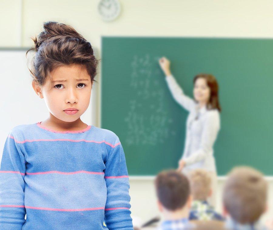 Sad Girl in Front of Chalkboard